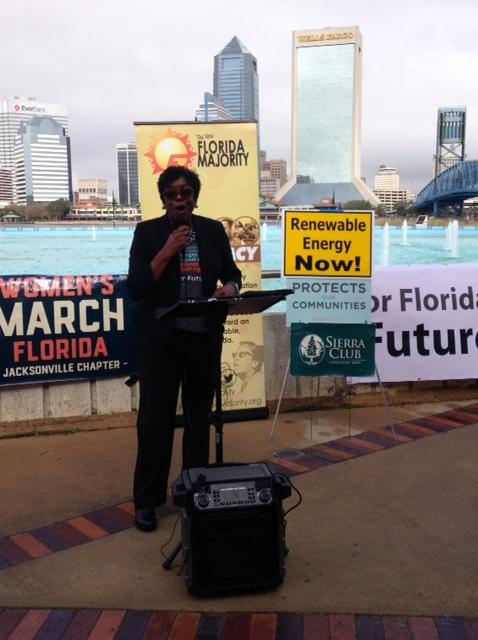 Local Awake the State organizer Pat McCollough with For Our Future addresses today's gathering at Friendship Fountain Park on the Southbank.
