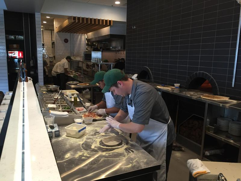Cooks make pizza at Il Desco in November of 2015.