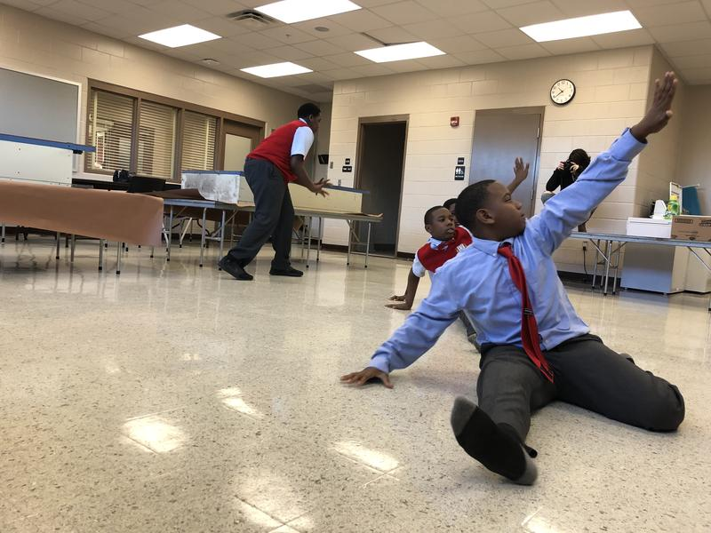 Four boys at Young Men's Leadership Academy at Eugene Butler Middle School take Savery Morgan's dance class.