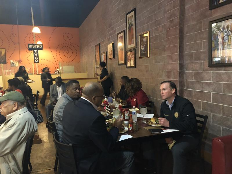 Jacksonville Mayor Lenny Curry eats lunch with some council members and constituents at  Soul Food Bistro Thursday.