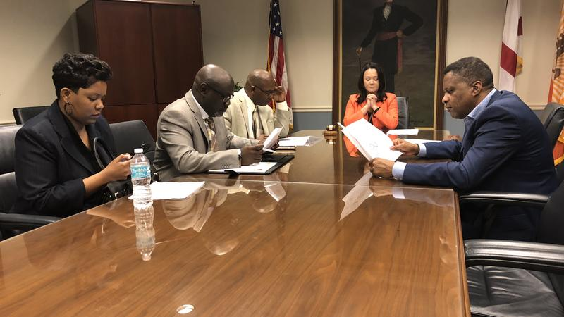 Council President Anna Lopez Brosche (middle) meets with city council members Katrina Brown (left), Sam Newby, Reggie Gaffney and Reggie Brown (right) Monday.