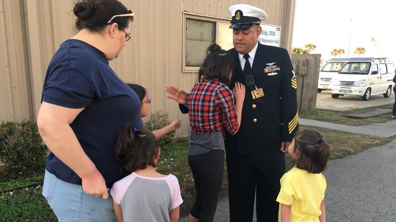 Chief Petty Officer Jason Resendez says goodbye to his wife, Amanda and daughters Eden (11), Olivia (8), Sydney (7) and Cadence (4)