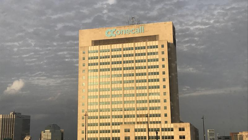 One Call's logo atop what used to be the Aetna building in downtown Jacksonville.