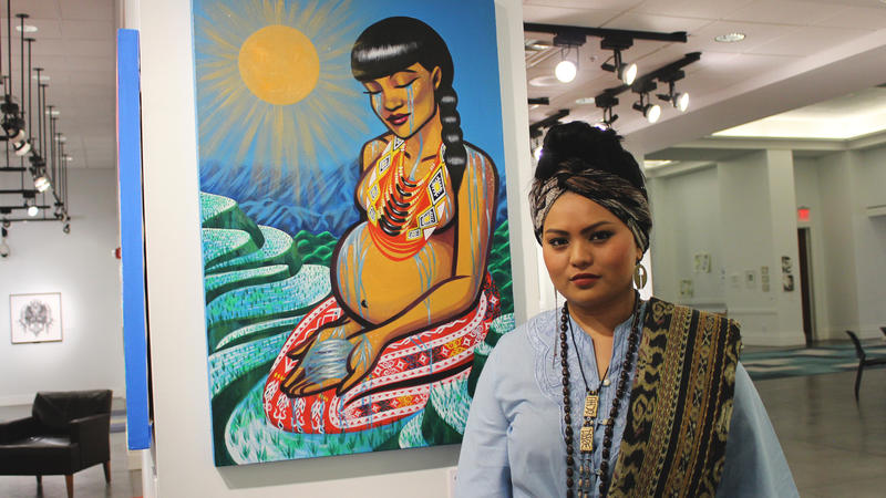 "Grace Bio displays her work ""Sacred Waters"" at the Jacksonville Public Library. Her painting represents the tears of healing that Filipina women have shed after centuries of colonial trauma."