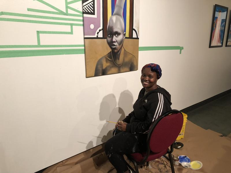 Yuzly Mathurin with her painting.