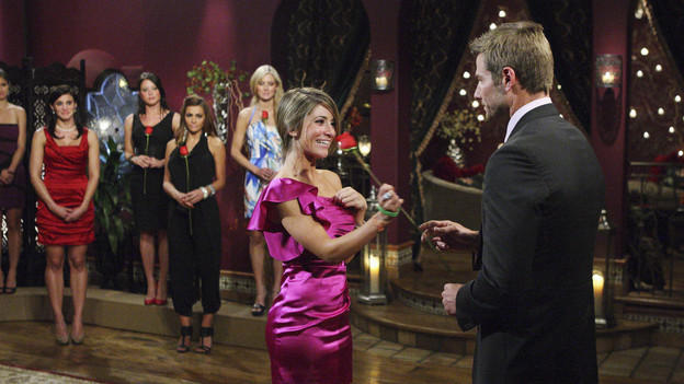 Bachelor handing out roses to everyone except one girl