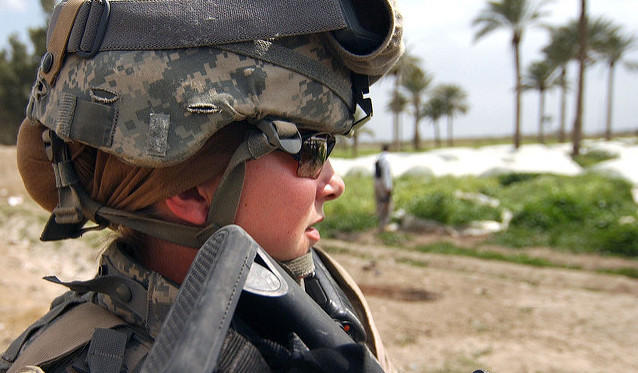 female Army servicemember with rifle