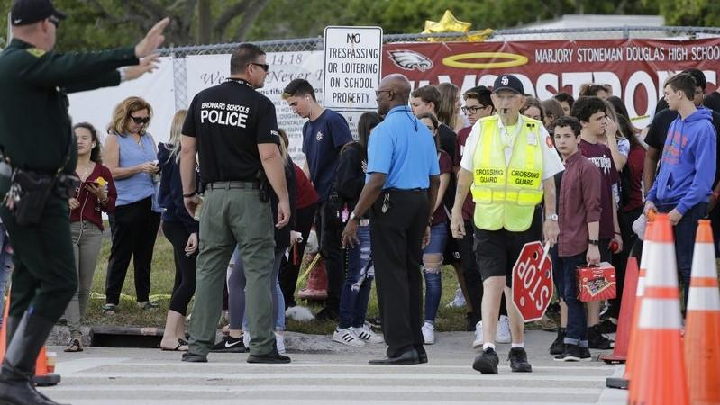 First reponders were on the scene as student waited to cross the street after their first day back at Marjory Stoneman Douglas High School in Parkland, Fla., Wednesday, Feb. 28, 2018.