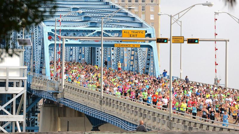 Runners make their way across the Main St. Bridge during the 38th Annual Gate River Run in 2015.