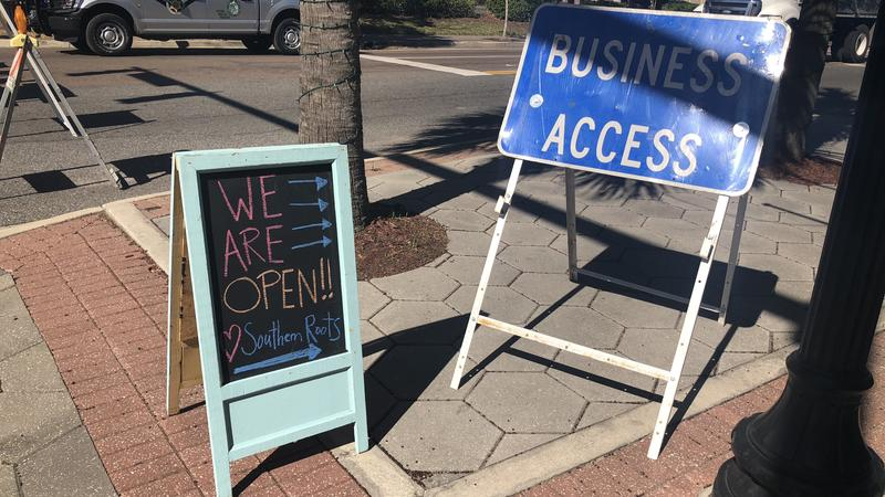 Businesses has sign to tell their customers they are still open.