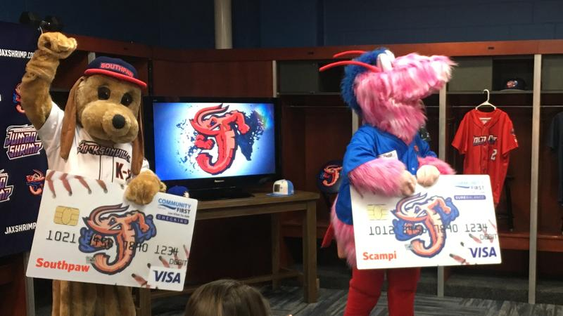 Jumbo Shrimp mascots Southpaw and Scampi announce the debit card Friday.