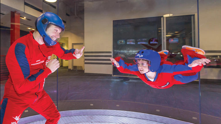 At iFly Indoor Skydiving, participants fly on a cushion of air generated by giant fans.