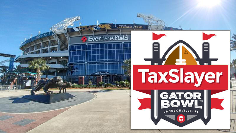The new TaxSlayer Gator Bowl Logo is shown in the foreground. TIAA Bank Field, formerly EverBank Field, is shown in the backgroun.