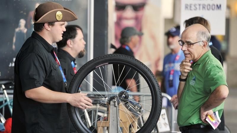 Seabrook Smith (left) from Emory Bicycles talks with Alan Zube, an advanced manufacturing instructor at Florida State College at Jacksonville, at Emory's booth at One Spark Friday afternoon. Emory Bicycles began making beach cruisers in Jacksonville in th