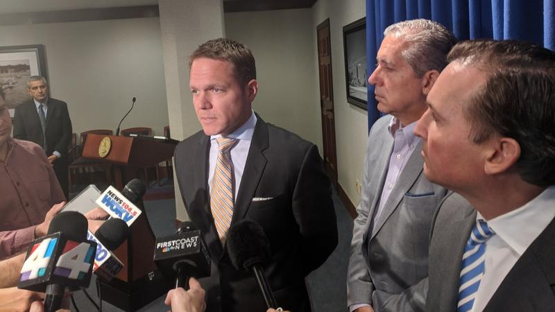 From left to right: JEA Interim CEO Aaron Zahn, JEA Board Chair Alan Howard, Jacksonville Mayor Lenny Curry at a press conference following Zahn's selection.