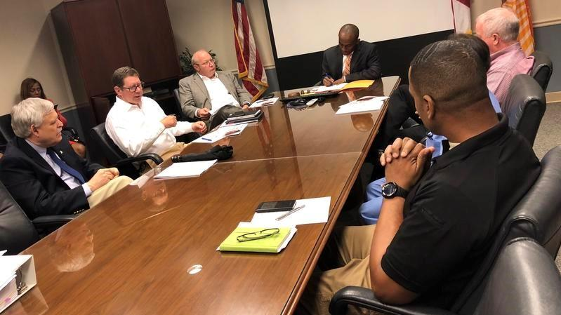 "Councilman Garrett Dennis leads a meeting with other council members, medical examiner's employees, and a Wolfson physician as they talk about ""hit-free zones"" on March 20."