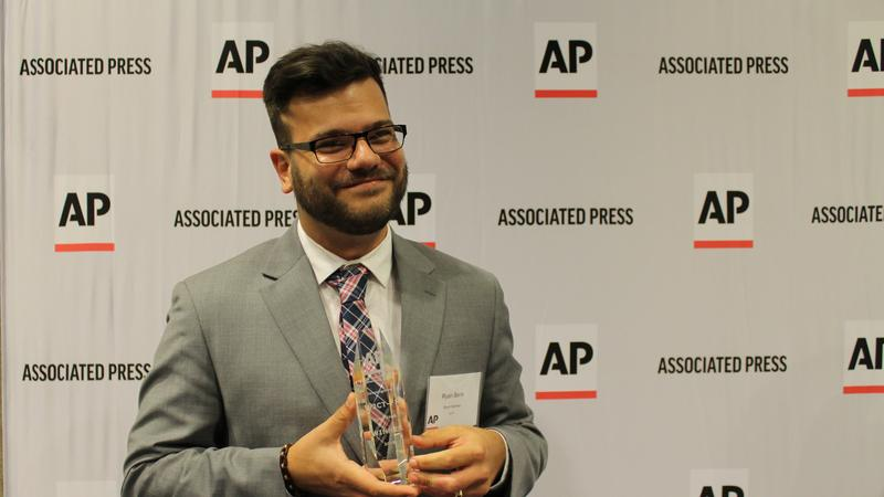 Ryan Benk accepts his award at the Florida AP Broadcasters ceremony on April 14, 2018.