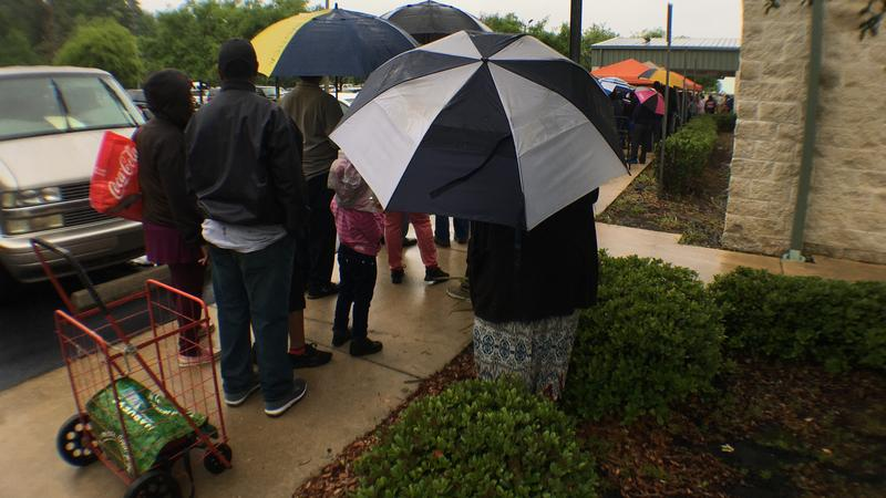 Hundreds of people waited in the rain at Feeding Northeast Florida's emergency food give away Saturday