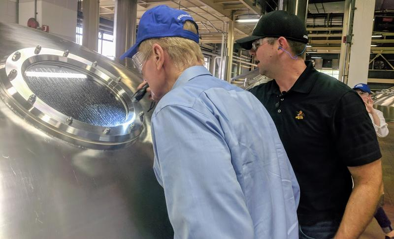 Nelson (left) peers into large beer tank at Anheuser-Busch's brewery in Jacksonville.