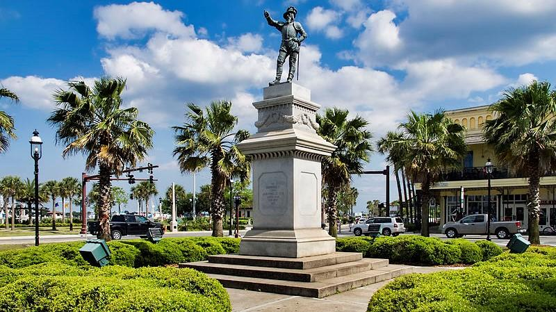 Palm trees surround the Ponce De Leon Statue in downtown St. Augustine.