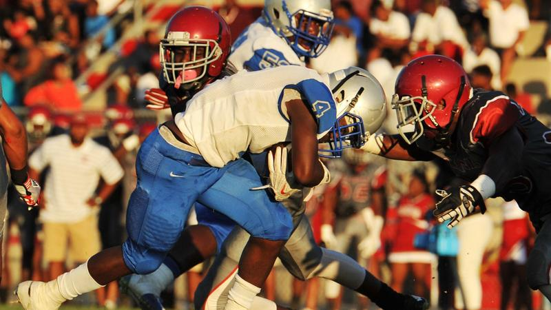 Lee High's Cameron Wakefield puts his head down and plows ahead for a touchdown against Raines in 2006.