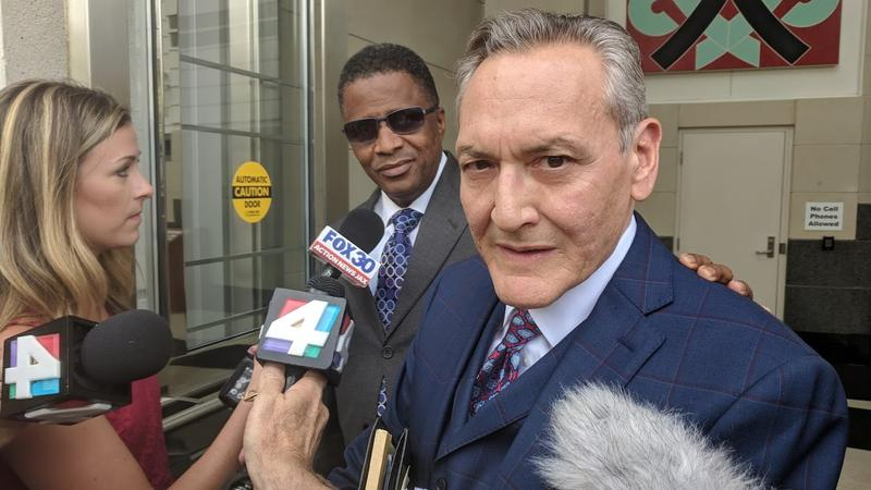 Councilman Reggie Brown (sunglasses, left) and his lawyer Alan Ceballos (right)