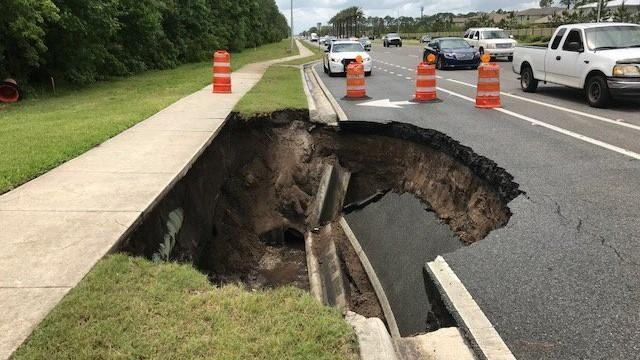 This hole appeared Wednesday in from of Wolf Creek Condominiums Wednesday on Beach Boulevard.