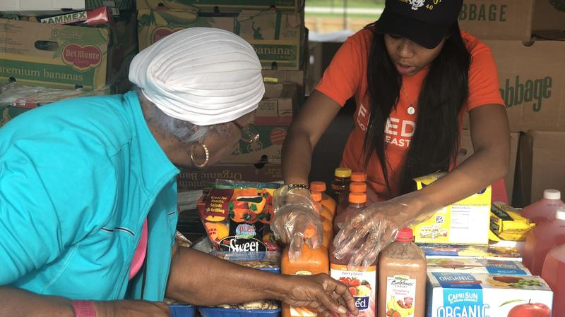 People living near KIPP charter schools go to Feeding Northeast Florida's pop-up food bank at the school Tuesday.