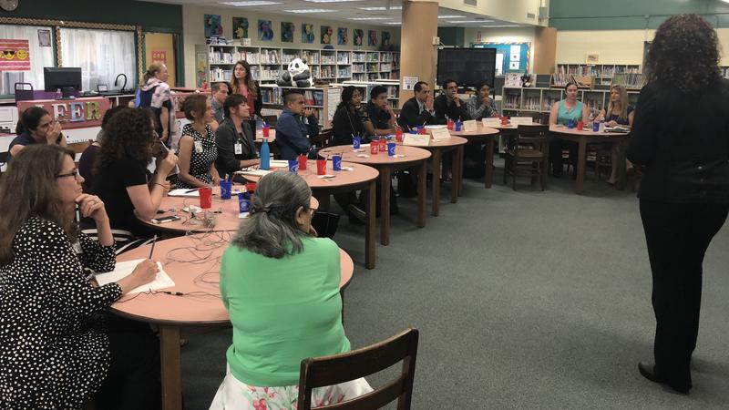 Visitors from Central and South American countries as well as distrct staff, listen to a presentation from the school distrct regarding diversity in Duval schools.