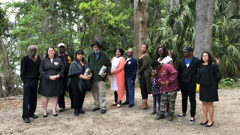 A group of community activists gather for a prayer service and soil collection in April at the site believed to be where Isaac Barrett was hanged.
