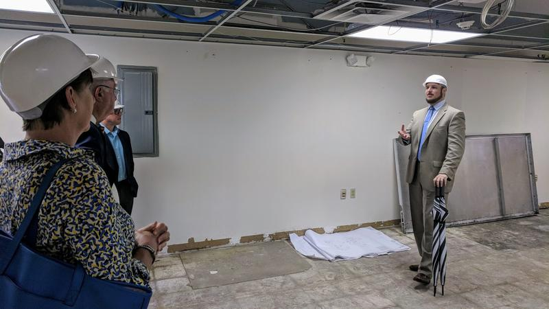 LISC Economic Development Officer Devin Thompson standing in what will eventually be the Financial Opportunity Center's main computer lab.