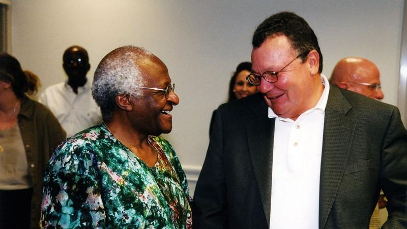 Archbishop Desmond Tutu is pictured in 2003 in with then-interim UNF President David Kline.