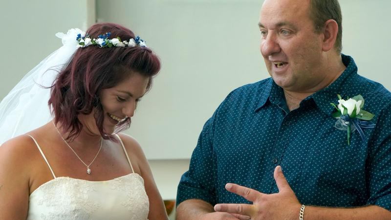 Newlyweds Dave Leek and Bobbie Godden admire their wedding bands following the ceremony, held Wednesday morning at UF Health Proton Therapy Institute.
