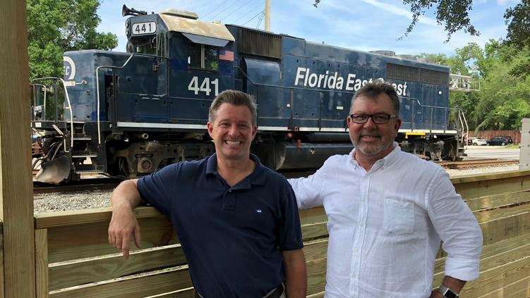 Mark Janasik, left, and Ned Jones expect to open the Southern Grounds coffee shop at 1671 Atlantic Blvd. this week. It sits along railroad tracks, providing daily entertainment as locomotives and trains pass by.