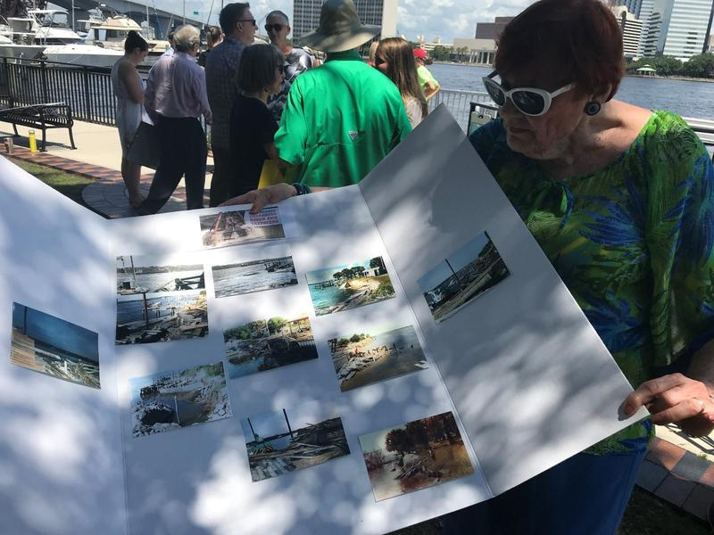 Dot Mathias, a Jacksonville Native shows WJCT photos she took of the effects of dredging off of Heckscher Drive in North Jacksonville.