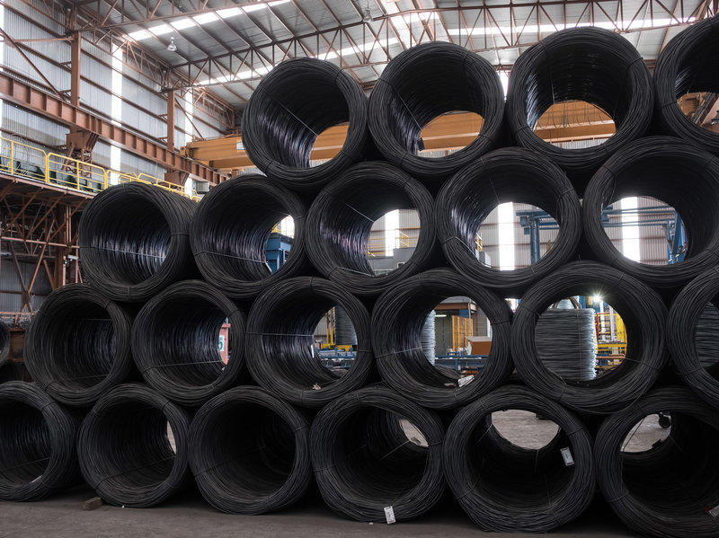 Coils of steel wire sit stacked in the shipping area of the Grupo Acerero SA steel processing facility in San Luis Potosi, Mexico, in March. Mexican steel will be subject to a 25 percent tariff.