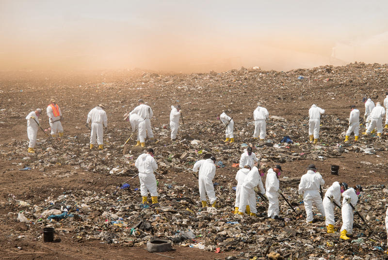 The FBI and Nassau County Sheriff's Office sift through trash at Chesser Island Landfill, looking for evidence.