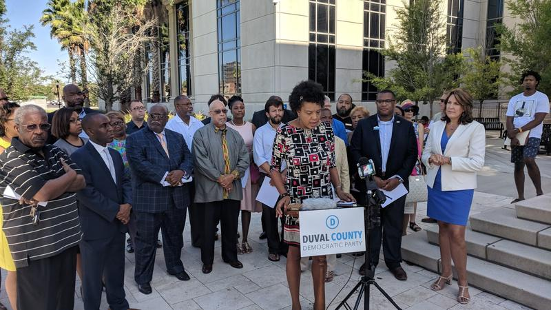 Duval Democrats and Brenda Priestly Jackson outside the Duval County Courthouse Monday.