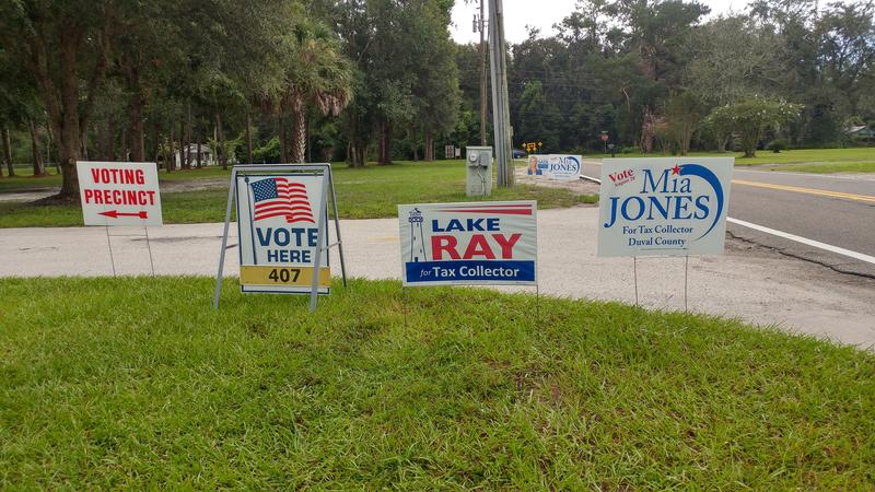 Campaign signs filled the public space around Duval County's Precinct 407 Tuesday morning. The precinct is hosted by Southpoint Baptist Church.