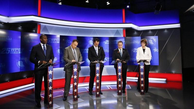 Democratic gubernatorial candidates, from right, Gwen Graham, Philip Levine, Chris King, Jeff Greene and Andrew Gillum await the start of a debate ahead of the Democratic primary for governor on Thursday, Aug. 2, 2018, in Palm Beach Gardens, Fla.