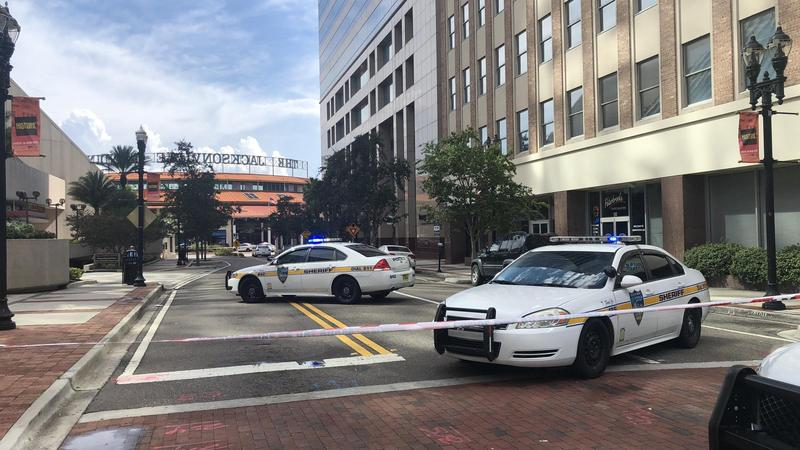 Jacksonville police blocked off the area around the Jacksonville Landing Sunday following a mass shooting.