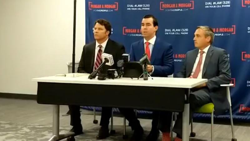 Seated Left to Right: Attorneys Timothy Moran, Matt Morgan, and James Young of Morgan & Morgan.