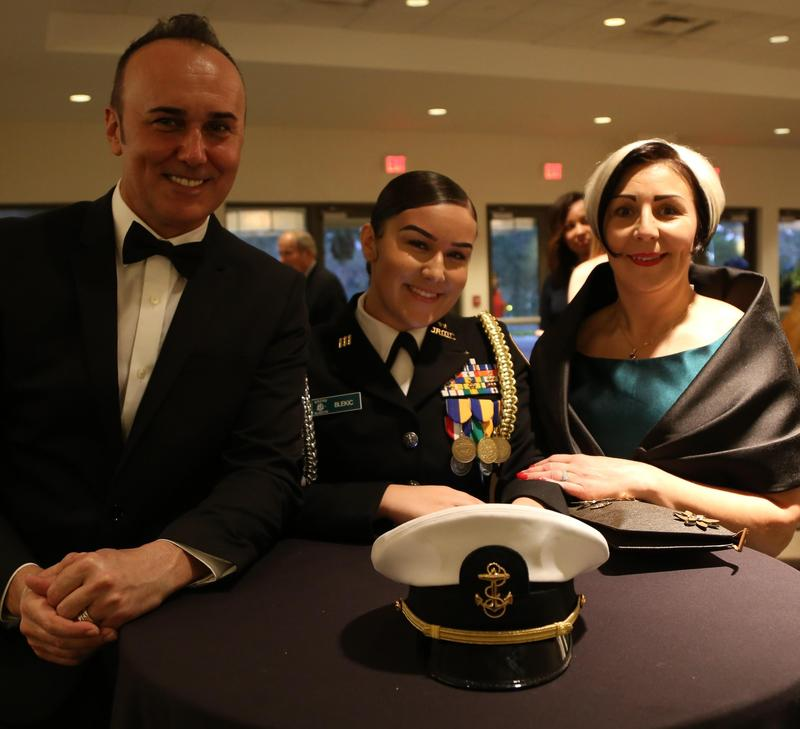 Medina Blekic (center) and her parents at the Nease Junior ROTC awards banquet earlier this year.