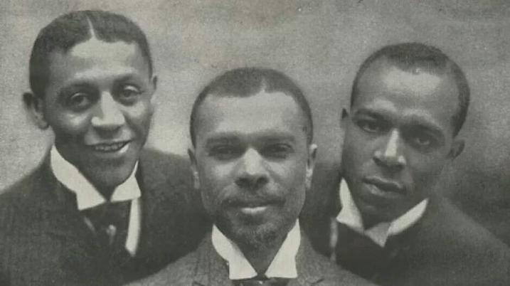 James Weldon Johnson (center) with friend Bob Cole (left) and brother Rosamond (right)