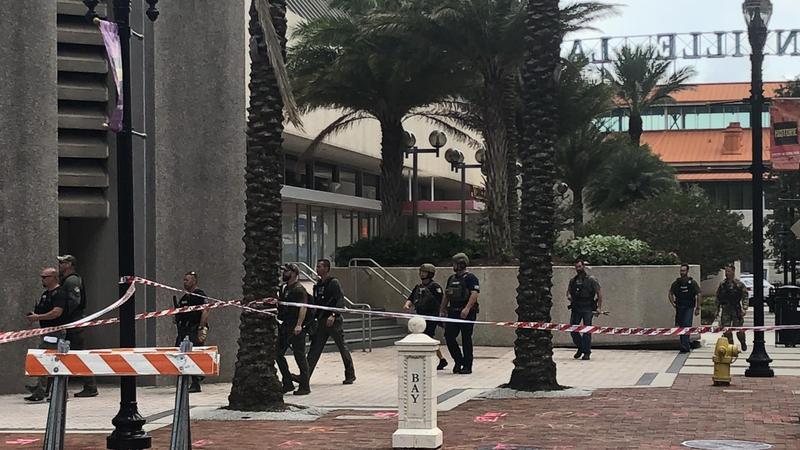 Police cordon off an area near the Jacksonville Landing on Sunday.