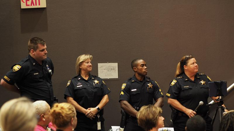 Four members of JSO's new LGBTQ liaison team attend the community forum.