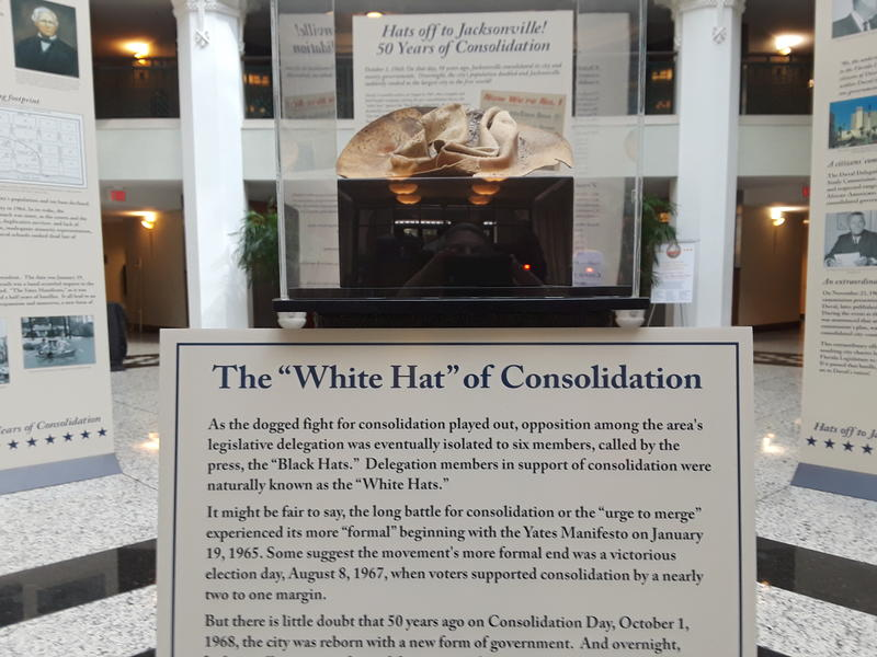 """One of the """"White Hats"""" worn by supporters of consolidation is on display in the atrium of Jacksonville City Hall."""