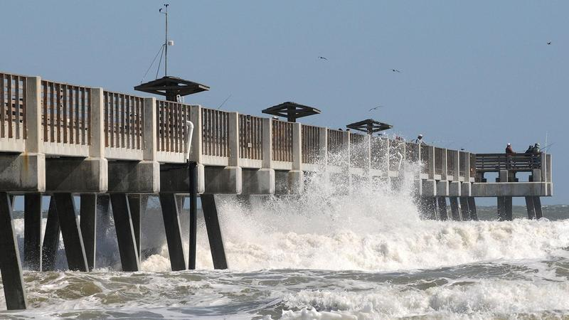 The Jacksonville Beach Pier is pictured during high surf in 2011.