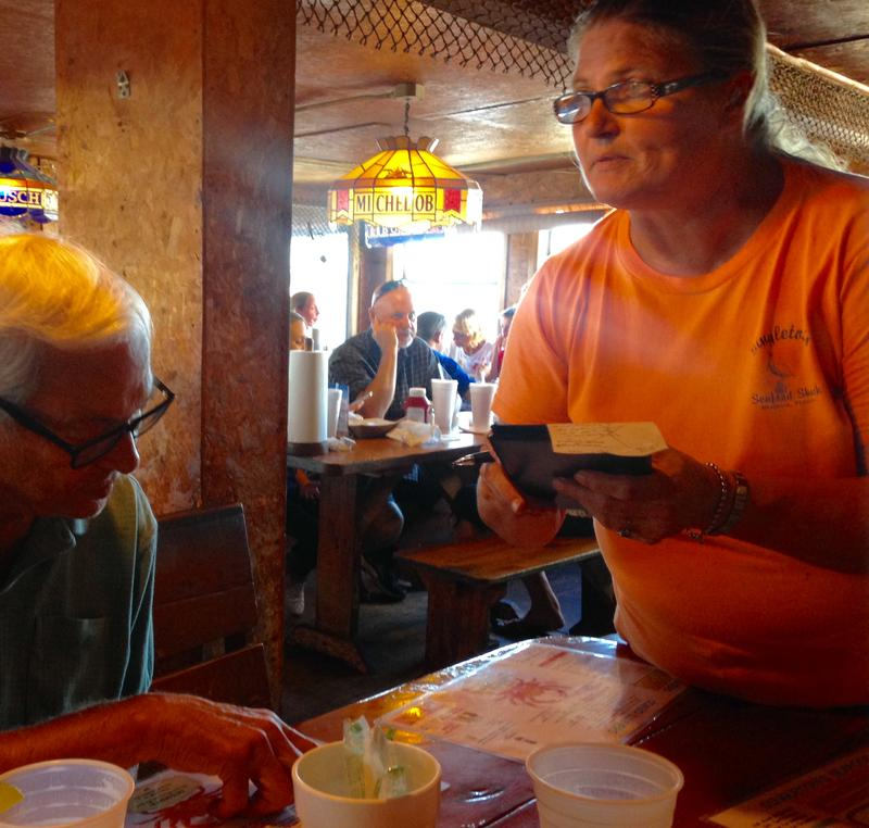 Jill Thomas serves a customer at Singleton's Seafood Shack in Mayport, which expects an 18% decrease in customers while the ferry is closed.