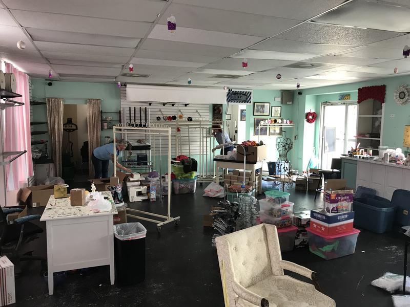 Owner Cindy Platt and her friend Sarah Diaz packing up Grease Rags' San Marco location.